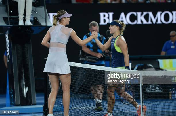 Maria Sharapova of Russia greets Angelique Kerber of Germany during women's singles third round match within the sixth day of 2018 Australia Open...