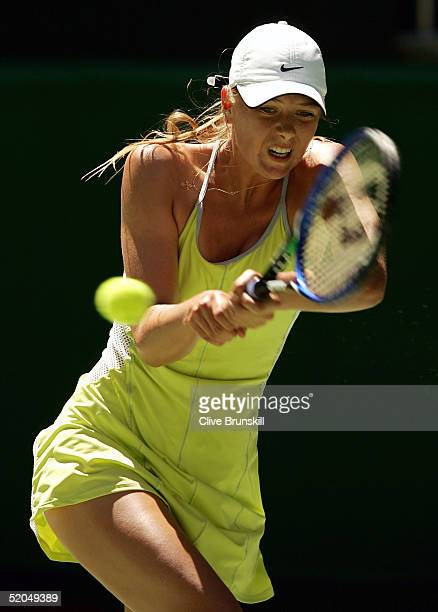 Maria Sharapova of Russia hits a backhand against Silvia Farina Elia of Italy during day seven of the Australian Open Grand Slam at Melbourne Park...