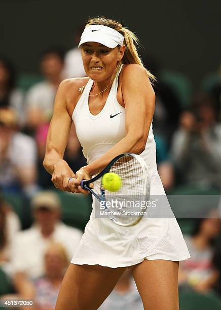 Maria Sharapova of Russia hits a backhand return during her Ladies' Singles third round match against Alison Riske of the United States on day six of...