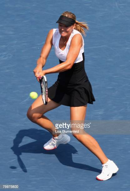 Maria Sharapova of Russia hits a backhand shot to Patty Schnyder of Switzerland during the Day 7 final match of the Acura Classic at the La Costa...