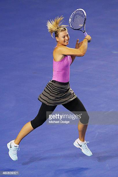 Maria Sharapova of Russia hits a forehand during practice ahead of the 2014 Australian Open at Melbourne Park on January 6 2014 in Melbourne Australia
