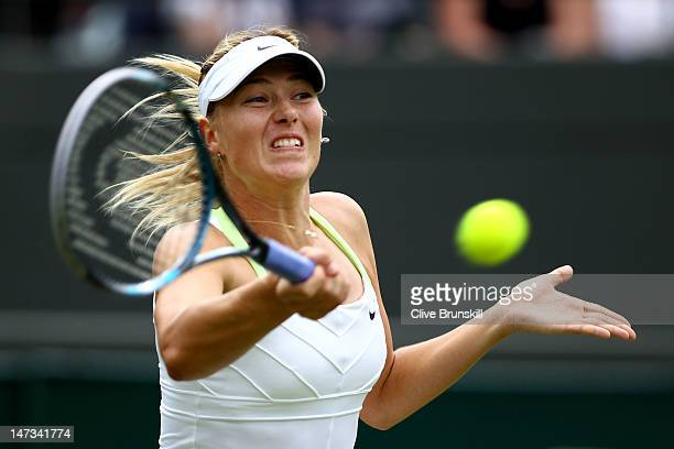 Maria Sharapova of Russia hits a forehand return during her Ladies' singles second round match against Tsvetana Pironkova of Bulgaria on day four of...