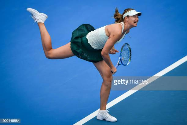 TOPSHOT Maria Sharapova of Russia hits a return against Alison Riske of the US during their women's singles second round match at the WTA Shenzhen...