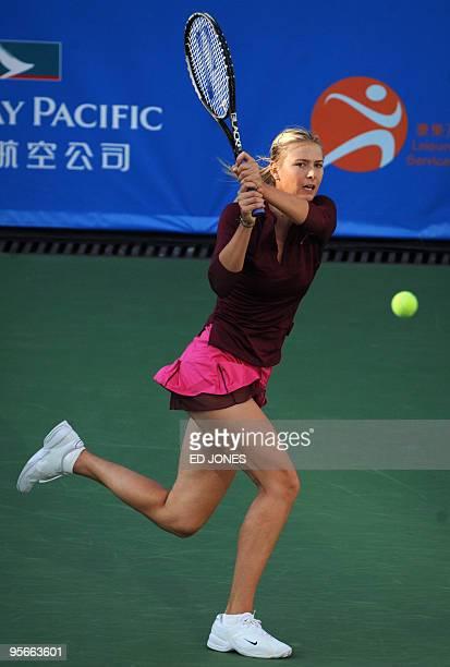 Maria Sharapova of Russia hits a return against Caroline Wozniacki of Poland during the women's singles final at the Hong Kong Tennis Classic...