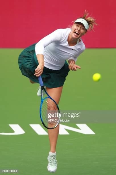Maria Sharapova of Russia hits a return against IrinaCamelia Begu of Romania during their women's singles first round match at the Tianjin Open...