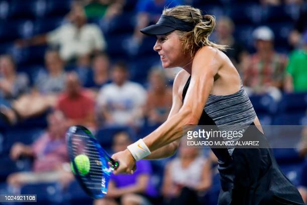 TOPSHOT Maria Sharapova of Russia hits a return to Patty Schnyder of Switzerland during their 2018 US Open women's match August 28 2018 in New York