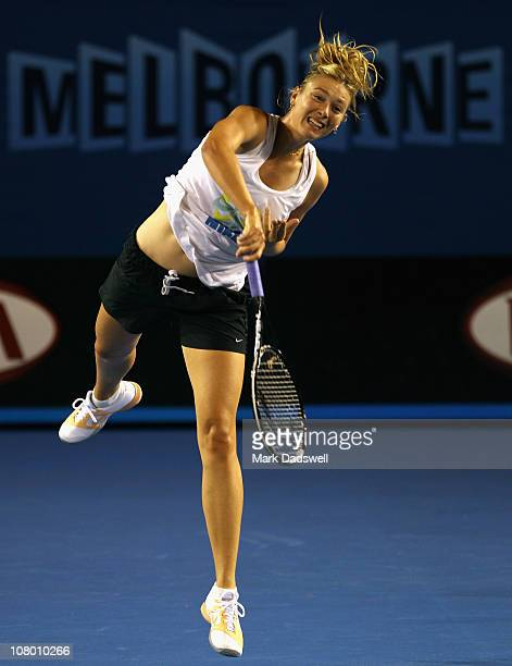 Maria Sharapova of Russia hits a serve during a practice session ahead of the 2011 Australian Open at Melbourne Park on January 13 2011 in Melbourne...