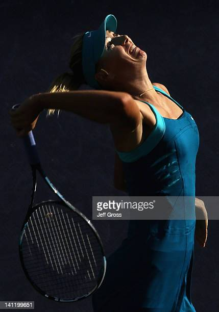 Maria Sharapova of Russia hits a serve to Simona Halep of Romania during the BNP Paribas Open at the Indian Wells Tennis Garden on March 12 2012 in...