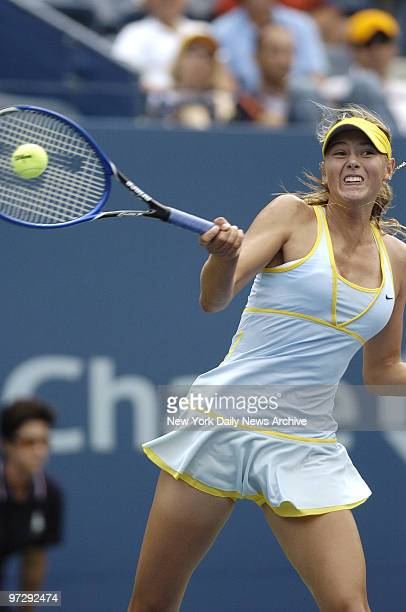Maria Sharapova of Russia hits a shot to Dally Randriantefy of Madagascar during second round play in the US Open at the Grandstand Stadium in...