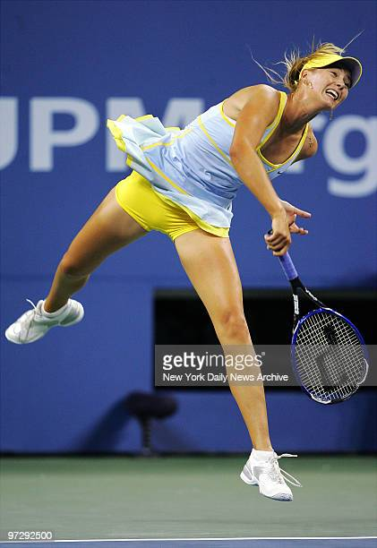 Maria Sharapova of Russia hits a shot to fellow Russian Nadia Petrova during quarterfinals in Arthur Ashe Stadium at the US Open in Flushing...