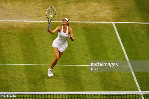 Maria Sharapova of Russia hits a volley during her Ladies' Singles third round match against Alison Riske of the United States on day six of the...