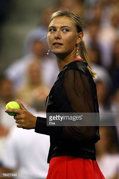 Maria Sharapova of Russia hits balls into the crowd after defeating after defeating Casey Dellacqua of Australia during day four of the 2007 US Open...
