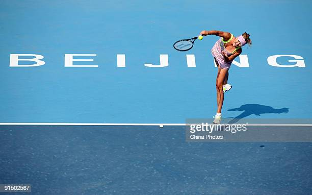 Maria Sharapova of Russia hits the ball against Victoria Azarenka of Belarus in her first round match during day five of the 2009 China Open at the...