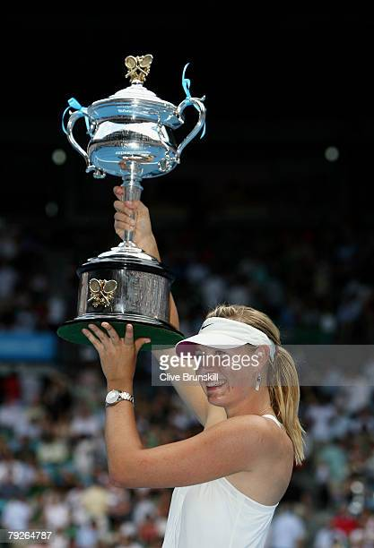 Maria Sharapova of Russia holds aloft the Daphne Akhurst Memorial Cup after winning the women's final match against Ana Ivanovic of Serbia on day...
