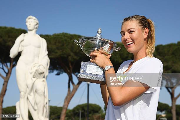 Maria Sharapova of Russia holds aloft the Winner's Trophy after her victory over Carla Suarez Navarro of Spain in the Women's Singles Final on Day...