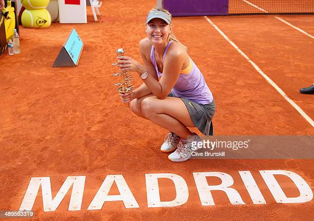 Maria Sharapova of Russia holds her winners trophy after her three set victory against Simona Halep of Romania in their final match during day nine...