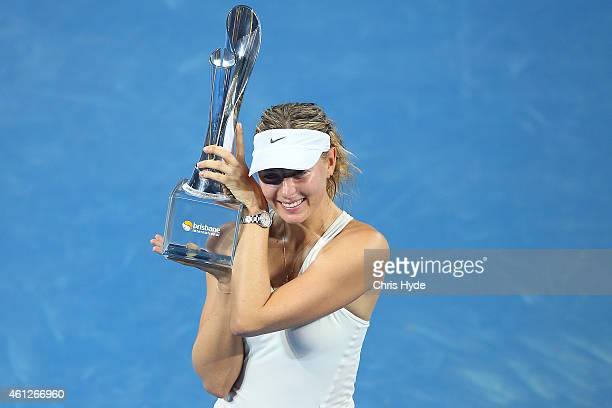 Maria Sharapova of Russia holds the Evonne Goolagong trophy after winning the Women's final match against Ana Ivanovic of Serbia during day seven of...