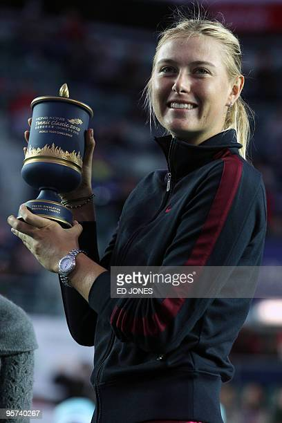 Maria Sharapova of Russia holds the trophy after defeating Caroline Wozniacki of Poland in the women's singles final of the Hong Kong Tennis Classic...