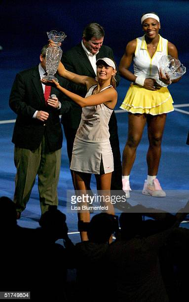 Maria Sharapova of Russia holds up the championship trophy after defeating Serena Williams in the finals of the WTA Tour Championship Tournament at...