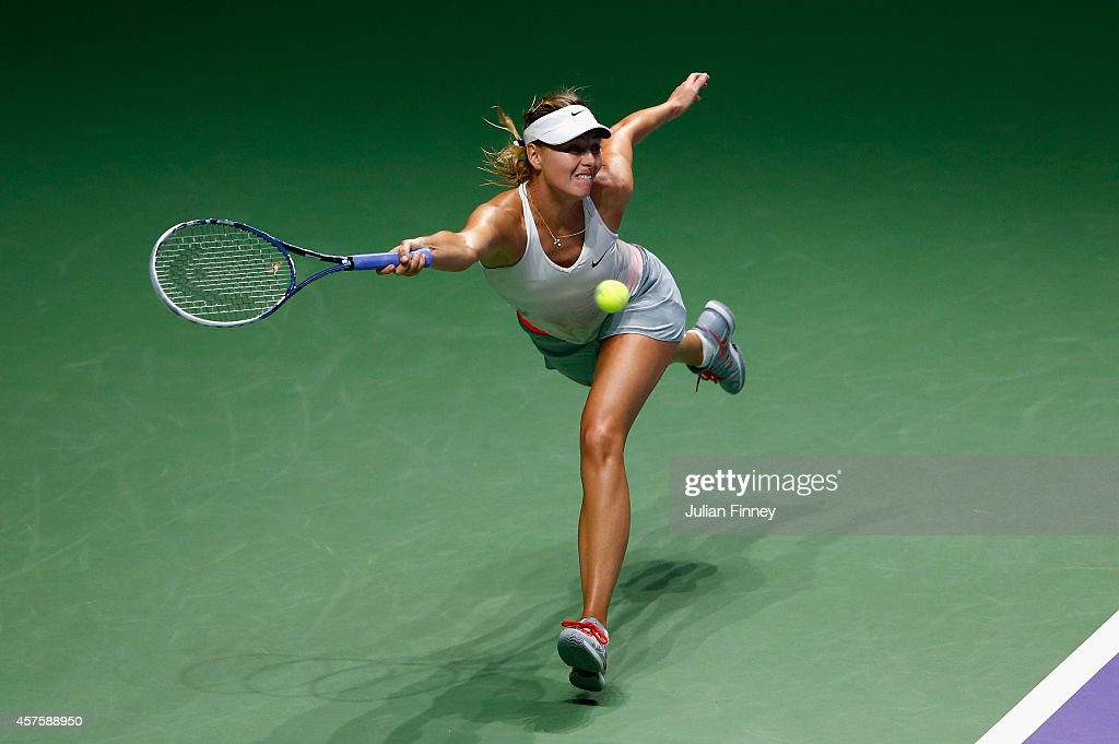 Maria Sharapova of Russia in action against Caroline Wozniacki of Denmark during day two of the BNP Paribas WTA Finals tennis at the Singapore Sports Hub on October 21, 2014 in Singapore.