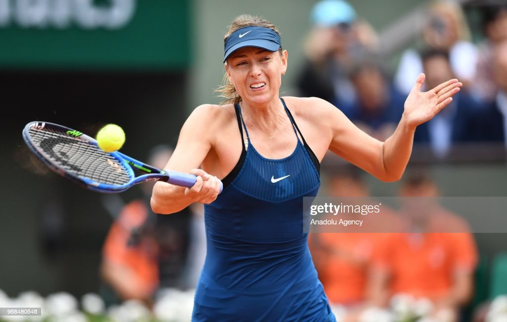 Maria Sharapova of Russia in action against Garbine Muguruza (not seen) of Spain during their quarter final match at the French Open tennis tournament at Roland Garros Stadium in Paris, France on June 06, 2018.