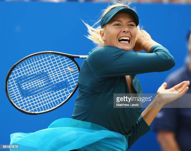 Maria Sharapova of Russia in action against Na Li of China during day Six of the AEGON Classic at the Edgbaston Priory Club on June 13 2009 in...