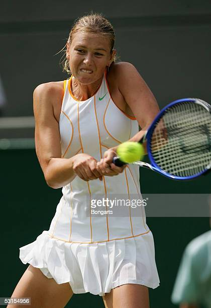 Maria Sharapova of Russia in action against Nathalie Dechy of France during the seventh day of the Wimbledon Lawn Tennis Championship on June 27,...