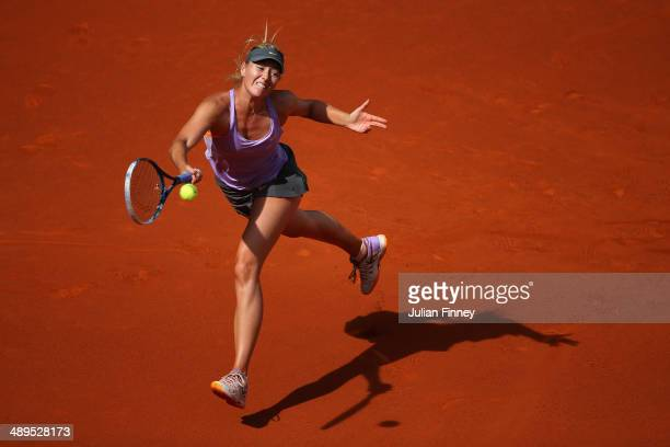 Maria Sharapova of Russia in action against Simona Halep of Romania in the final during day nine of the Mutua Madrid Open tennis tournament at the...
