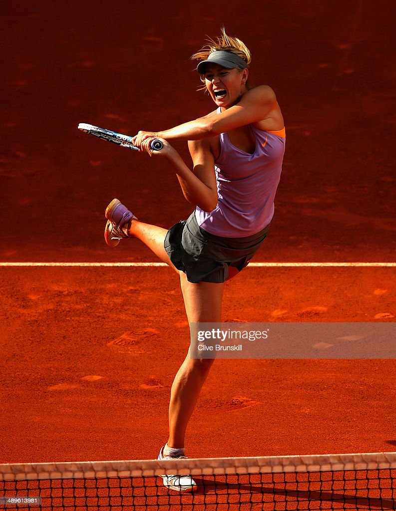 Maria Sharapova of Russia in action against Simona Halep of Romania in their final match during day nine of the Mutua Madrid Open tennis tournament at the Caja Magica on May 11, 2014 in Madrid, Spain.
