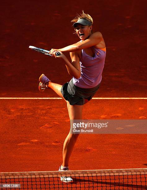 Maria Sharapova of Russia in action against Simona Halep of Romania in their final match during day nine of the Mutua Madrid Open tennis tournament...