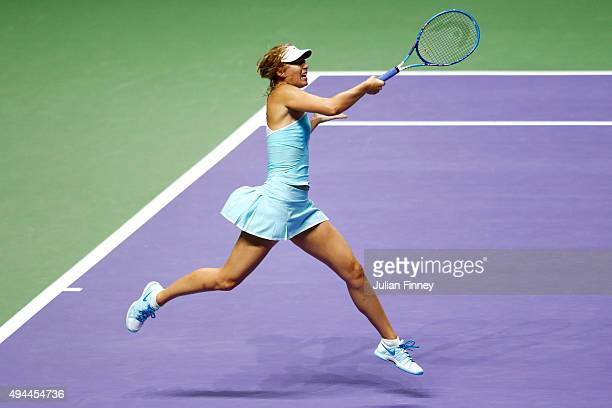 Maria Sharapova of Russia in action against Simona Halep of Romania in a round robin match during the BNP Paribas WTA Finals at Singapore Sports Hub...