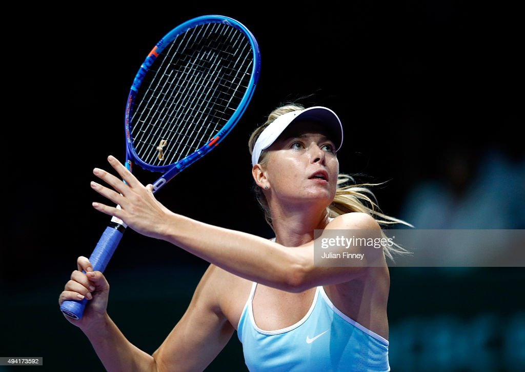 Maria Sharapova of Russia in action during a round robin match againt Agnieszka Radwanska of Poland during the BNP Paribas WTA Finals at Singapore Sports Hub on October 25, 2015 in Singapore.