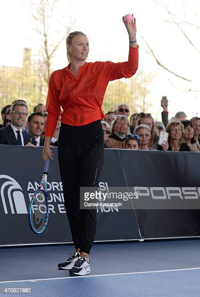 Maria Sharapova of Russia in action during his show match against Andre Agassi of the USA on day two of Porsche Grand Prix at Porsche Museum on April...