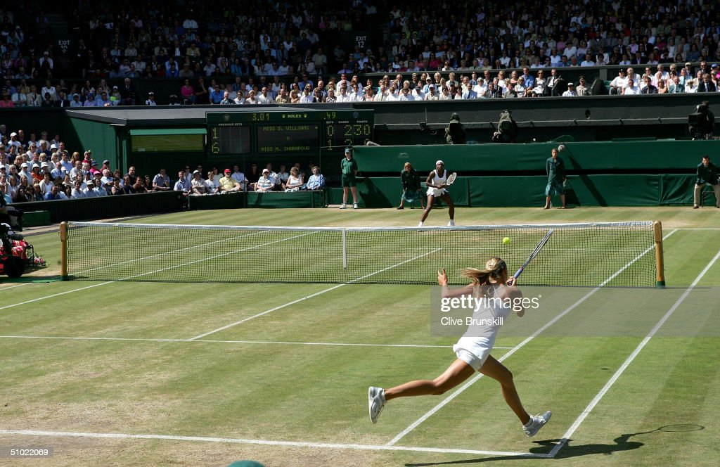 Maria Sharapova of Russia in action during the ladies final match against Serena Williams of USA at the Wimbledon Lawn Tennis Championship on July 3, 2004 at the All England Lawn Tennis and Croquet Club in London. Sharapova won 6-1 6-4.