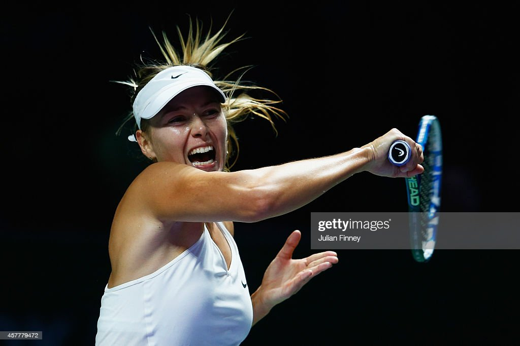 Maria Sharapova of Russia in action in her match against Agnieszka Radwanska of Poland during day five of the BNP Paribas WTA Finals tennis at the Singapore Sports Hub on October 24, 2014 in Singapore.