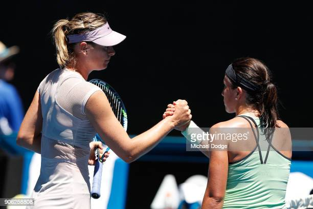 Maria Sharapova of Russia is congratulated by Anastasija Sevastova of Latvia after winning their second round match on day four of the 2018...