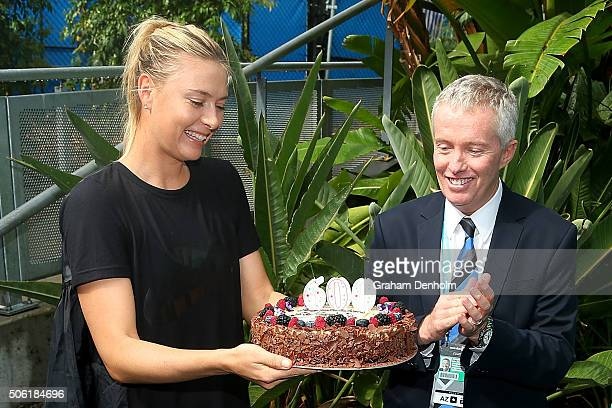 Maria Sharapova of Russia is presented with a cake by Australian Open Tournament Director Craig Tiley to commemorate her 600th career singles win...