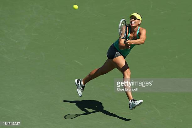 Maria Sharapova of Russia jumps to play a backhand against Sara Errani of Italy during their quarter final match at the Sony Open at Crandon Park...
