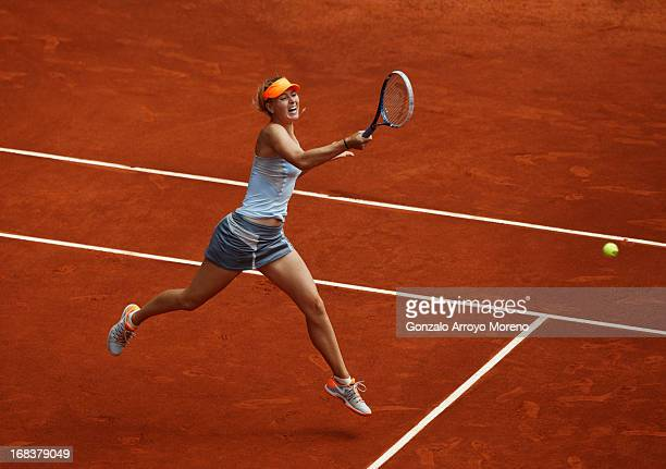 Maria Sharapova of Russia jumps to play a forehand to Sabine Lisicki of Germany on day six of the Mutua Madrid Open tennis tournament at the Caja...