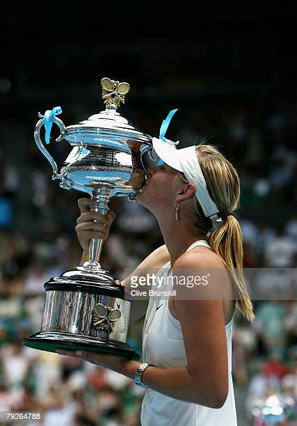 Maria Sharapova of Russia kisses the Daphne Akhurst Memorial Cup after winning the women's final match against Ana Ivanovic of Serbia on day thirteen...