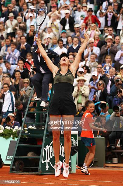 Maria Sharapova of Russia leaps in the air as she celebrates match point in the women's singles final against Sara Errani of Italy during day 14 of...