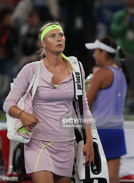 Maria Sharapova of Russia leaves after her defeat by Peng Shuai of China in her third round match during day six of the 2009 China Open at the...