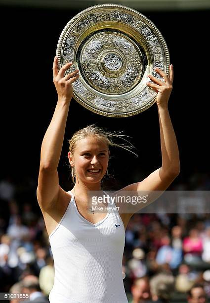 Maria Sharapova of Russia lifts her trophy after her victory against Serena Williams of USA in the ladies final match at the Wimbledon Lawn Tennis...