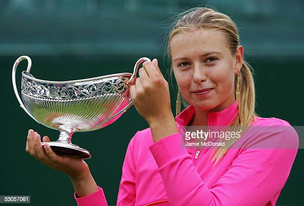 Maria Sharapova of Russia lifts the DFS Clasic Trophy after her final match against Jelena Jankovic of Serbia during the DFS Classic Women's...