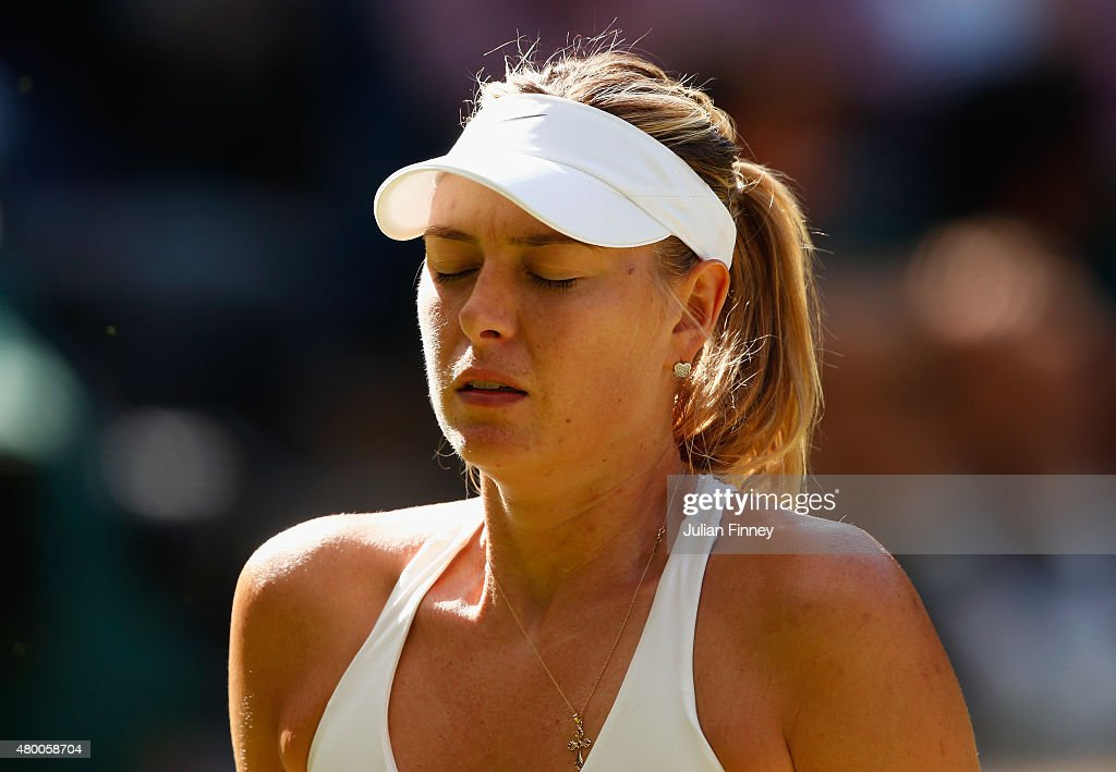 Maria Sharapova of Russia looks dejected in the Ladies Singles Semi Final match against Serena Williams of the United States during day ten of the Wimbledon Lawn Tennis Championships at the All England Lawn Tennis and Croquet Club on July 9, 2015 in London, England.