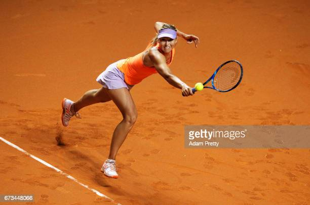 Maria Sharapova of Russia lunges for a backhand during her match against Roberta Vinci of Italy during the Porsche Tennis Grand Prix at Porsche Arena...