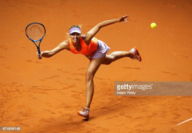 Maria Sharapova of Russia lunges for a forehand during her match against Kristina Mladenovic of France during the Porsche Tennis Grand Prix at...