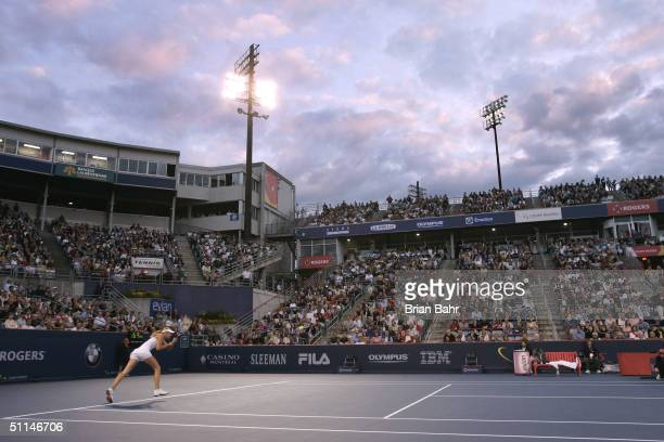 Maria Sharapova of Russia lunges for a serve from Vera Zvonareva of Russia during their third round match of Rogers Cup tennis on August 5, 2004 at...
