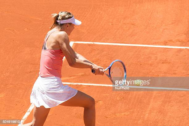 Maria Sharapova of Russia plays a against Mariana DuqueMarino of Colombia in their second round match during day four of the Mutua Madrid Open tennis...