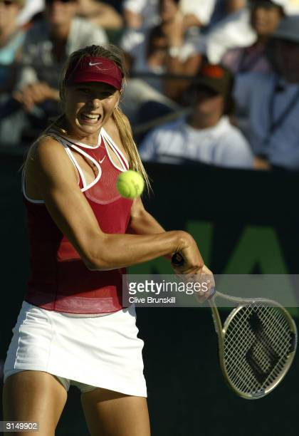 Maria Sharapova of Russia plays a backhand against Anna SmashnovaPistolesi of Israel during the third round of the Nasdaq 100 Open on March 28 2004...